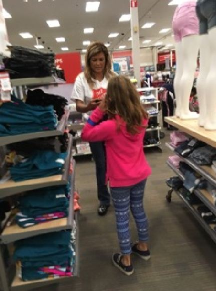 Woman helping child shop